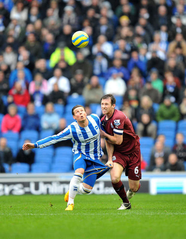 SHORTS STORY: Brighton's Will Hoskins, left, and Newcastle United's Mike Williamson battle for the ball in the FA Cup third round on Saturday