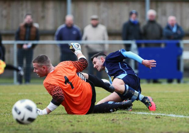 SLIDING HOME: Kieran Megran scores the first goal for Bishop Auckland