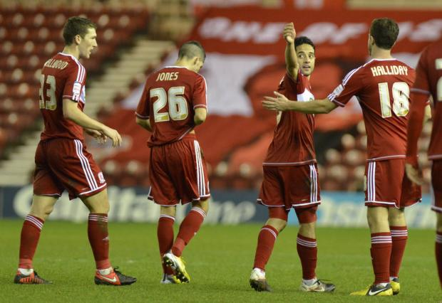MEROUANE MAGIC: Merouane Zemmama is congratulated after scoring his second goal and Middlesbrough's third duri