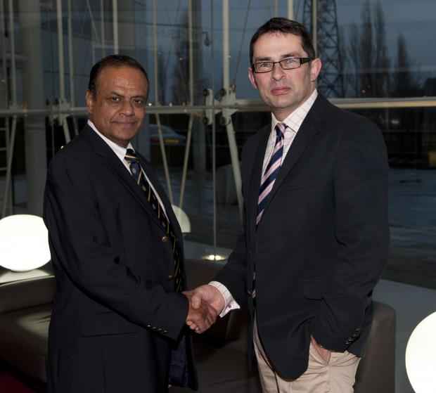 Ravindra Chamaria, of Infinity, seals the deal with Durham School headmaster Martin George