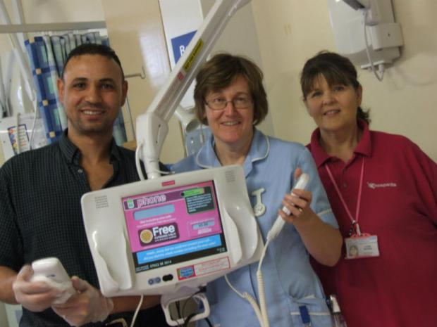 Domestic Reda El-Sayed pictured with staff nurse Christine Drury and Hospedia site operator Lesley Smedley.