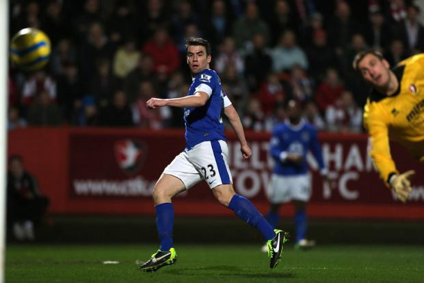 RACING TO VICTORY: Everton's Seamus Coleman scores his side's fourth goal during last night's comfortable 5-1 FA Cup third round win at Cheltenham - with a trip to the winners of next week's Sunderland v Bolton replay next up for the Toffees