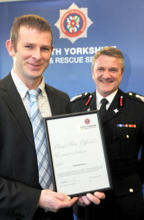 ACCOLADE: Dafydd Williams with his commendation certificate presented by Chief Fire Officer Nigel Hutchinson at Easingwold fire training centre
