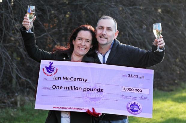 RAISING THE GLASS: Kim and Ian McCarthy from Washington who won £1m on the Euro lottery