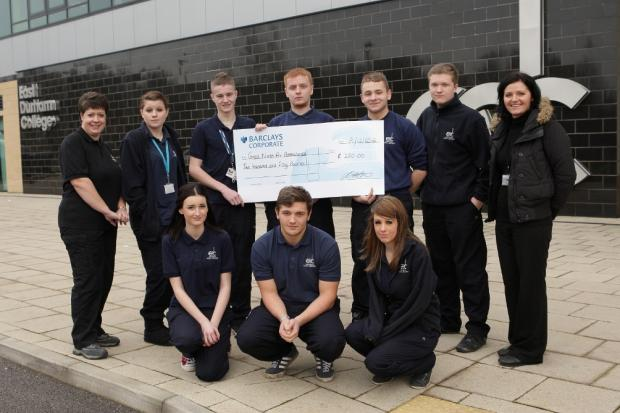 Students hand over cheque