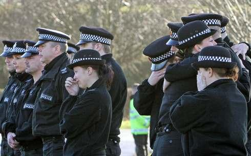 Former colleagues of PC Andrew Bramma from Greater Manchester Police at the accident scene