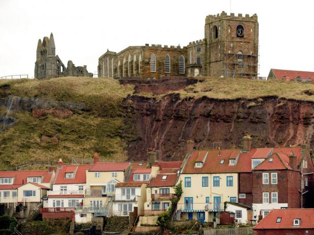 Graves around St Mary's in Whitby are exposed by landslips