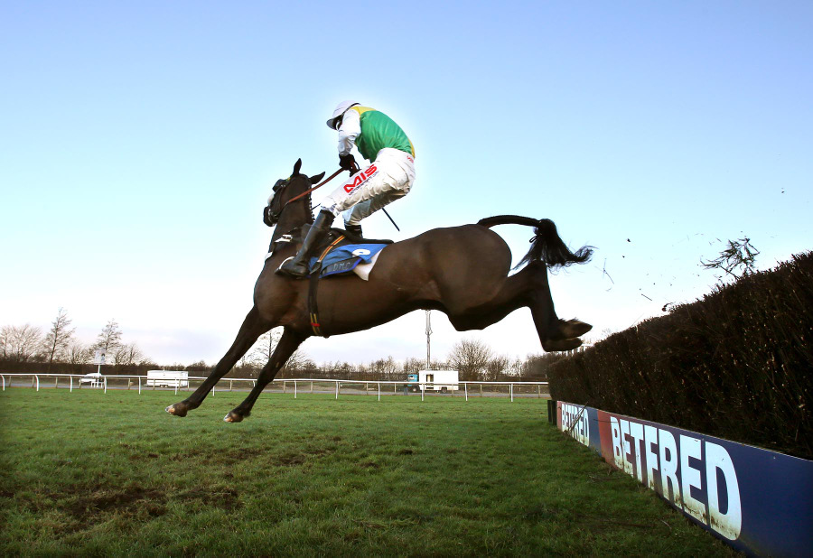 EVASIVE ACTION: Harry Haynes just manages to hold on to King Fontaine in the North Yorkshire Grand National at Catterick