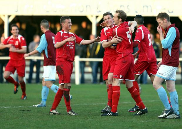 ALL SMILES: Gary Brown (5) and his Darlington team-mates celebrate his first-half goal against South Shields