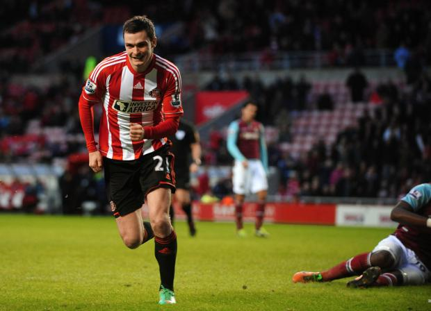 The Northern Echo: OFF AND RUNNING: Adam Johnson celebrates the second of Sunderland's three goals against West Ham