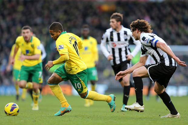 ON THE MOVE: Norwich City striker Simeon Jackson pulls away from Newcastle's want-away defender Fabricio Coloccini