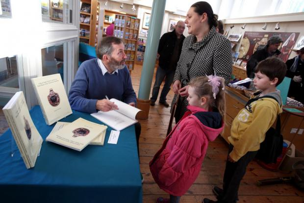 ROYAL FIND: Dr Steve Sherlock, who discovered the Saxon Princess jewellery at Loftus, a piece of which is shown below, signs copies of his book at Kirkleatham Museum