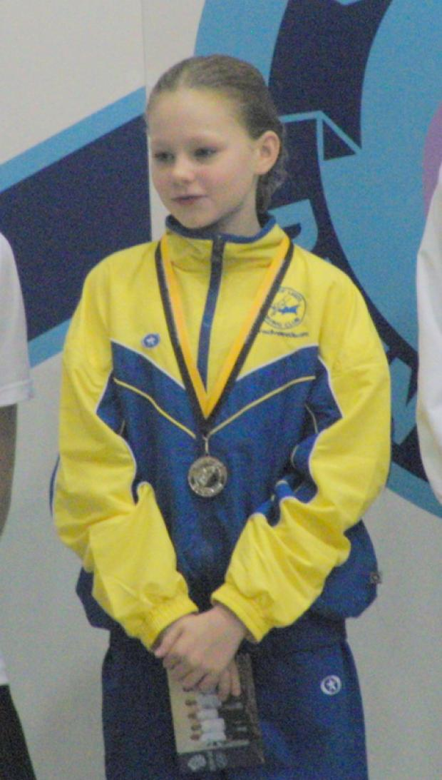 HIGH HOPES: Emily Bearpark with a silver medal she won in a competition in Leeds in October