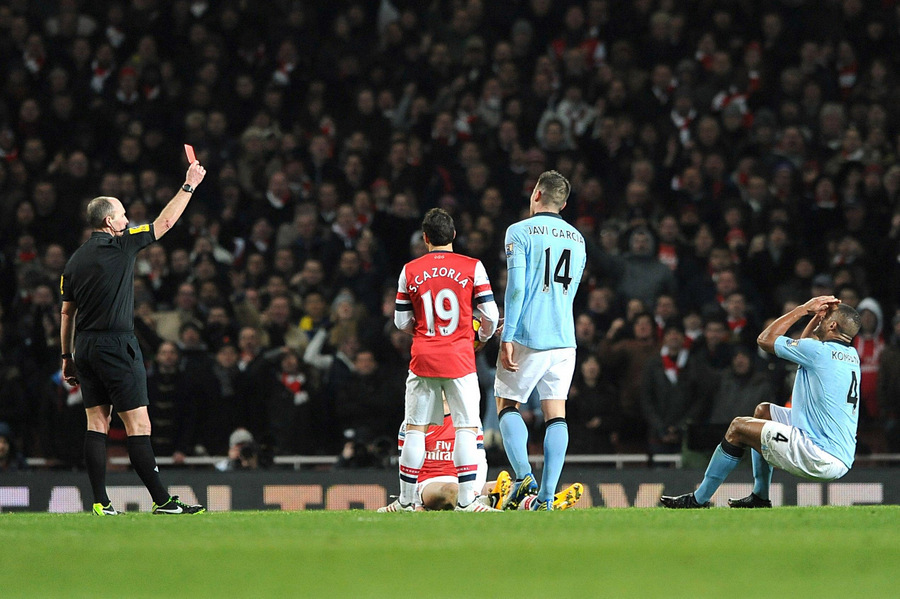 PARTING KOMPANY: Vincent Kompany (right) shows his disbelief on being shown a red card against Arsenal