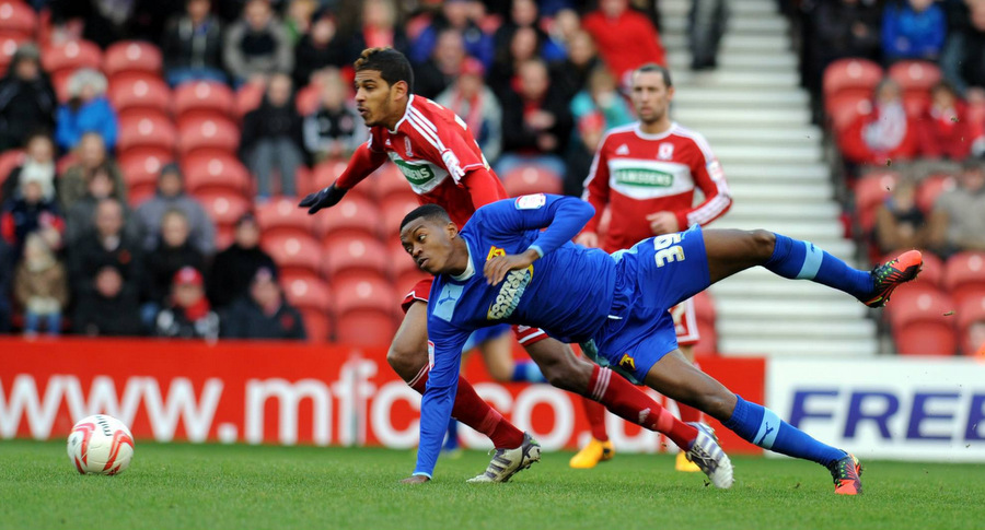 STUNG: Middlesbrough's Faris Haroun tussles with Nathaniel Chalobah during Saturday's home defeat to the Hornets