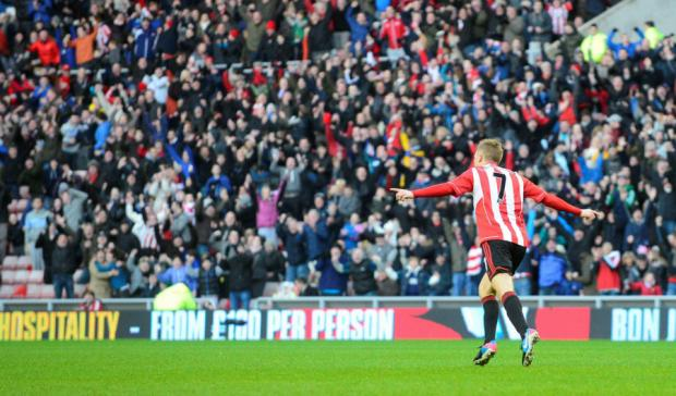 SEBASTIAN'S SCREAMER: Sunderland's Sebastian Larsson races away in delight after scoring a stunning long-range goal to put the Black Cats 1-0 up against West Ham United on Saturday