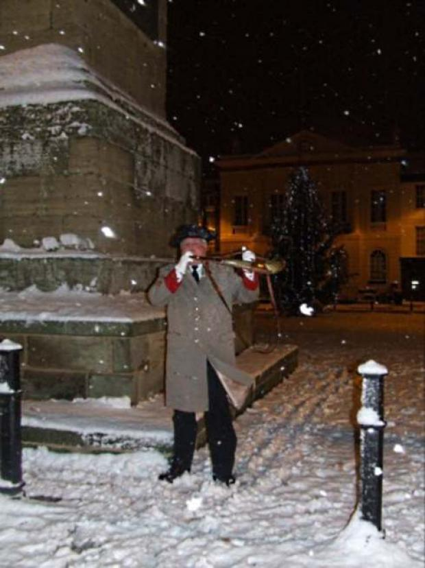 George Pickles, the Hornblower, pictured in 2010 doing his duty in the snow and bitter cold.