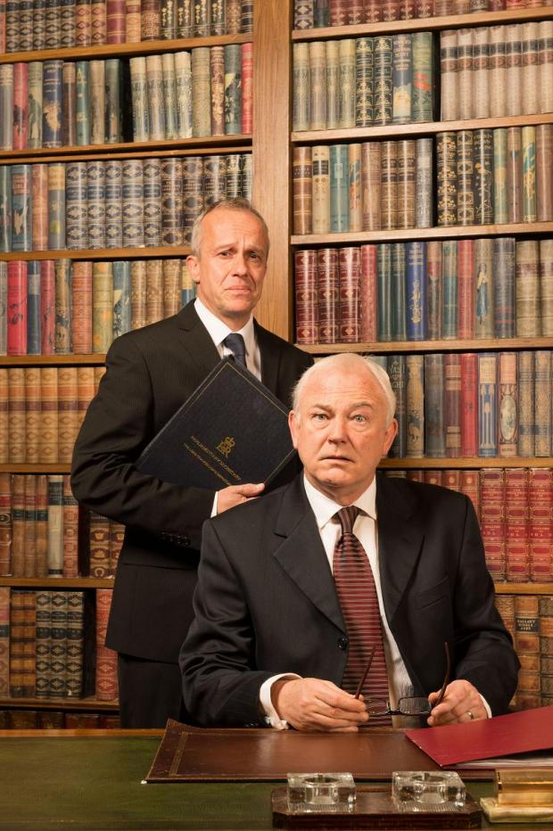 Crispin Redman, as Sir Humphrey, and Michael Fenton-Stevens, as Prime Minister Jim Hacker, star in Yes, Prime Minister