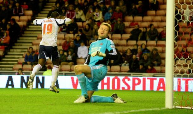 KNOCK OUT: Keeper Simon Mignolet appears dejected as Bolton's Marvin Sordell celebrates scoring