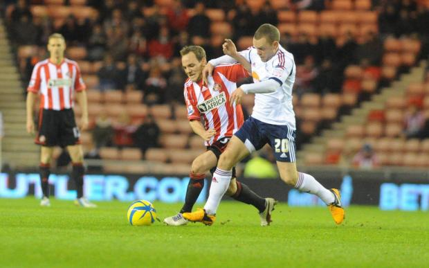 The Northern Echo: LACK ON INTEREST: Sunderland's David Vaughan holds off Bolton's Jay Spearing at the Stadium of Light last night during a game that attracted a crowd of only 17,505