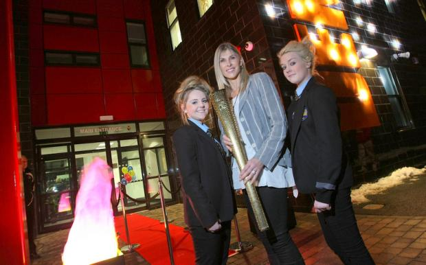 OFFICIAL OPENING: Sharon Davies opens the Dene Community School with year 11 students Ashleigh Dunleavy, left, and Hannah Olver