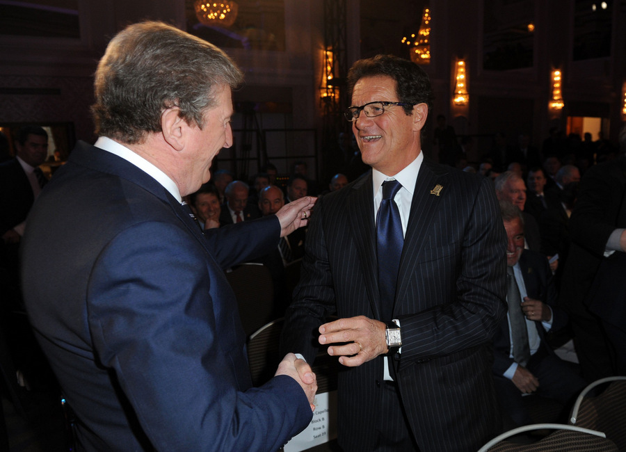 PAST AND PRESENT: Former England manager Fabio Capello greets current boss Roy Hodgson during the FA Anniversary celebrations launch yesterday