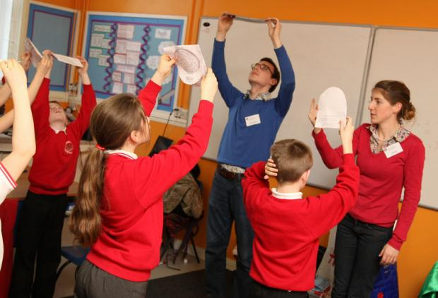 LOOK UP: Astronomers Charles Finn and Alice Danielson, from Durham University, teach St Godric's pupils to use a star wheel