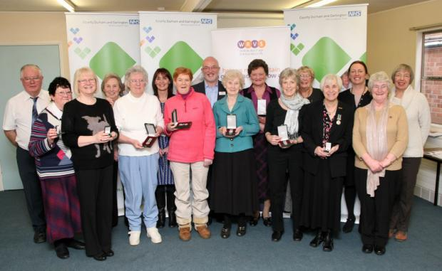 AWARDS GIVEN: WRVS volunteers with David McCullough, centre, and Sue Jacques, third from right