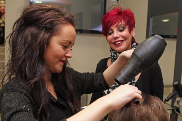 PASSING ON SKILLS: Katie Barton, 16, with new boss Ruth Roddam, who owns Saks hair salon in Darlington.