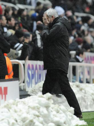 SHOCK LOSS: Alan Pardew buries his head in his hands after seeing Adam le Fondre put Reading 2-1 up on Saturday - securing the Royals first away win of the season