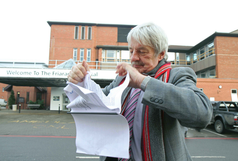 LOCAL ANGER: Councillor John Blackie of the health scrutiny committee rips up a copy of the report