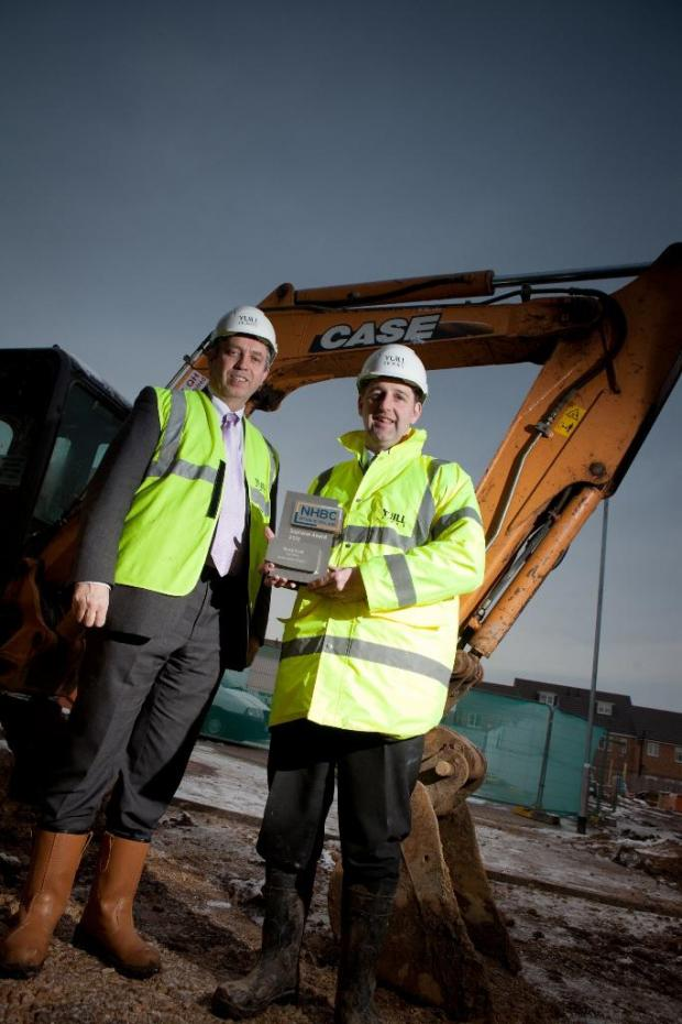 AWARD WINNER: Yuill Homes managing director David Mullins with site manager Steve Cook and his award