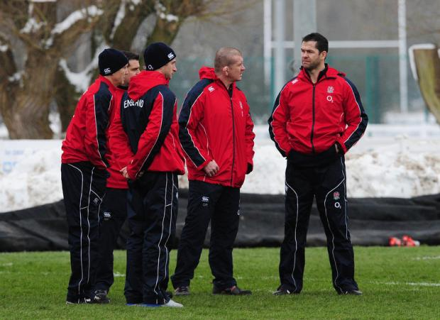 TALKING POINT: England's Andy Farrell, right, has responded to comments made by Scotland's interim coach Scott Johnson. He is pictured with Graham Rowntree and other members of the coaching staff during training in Leeds yesterday
