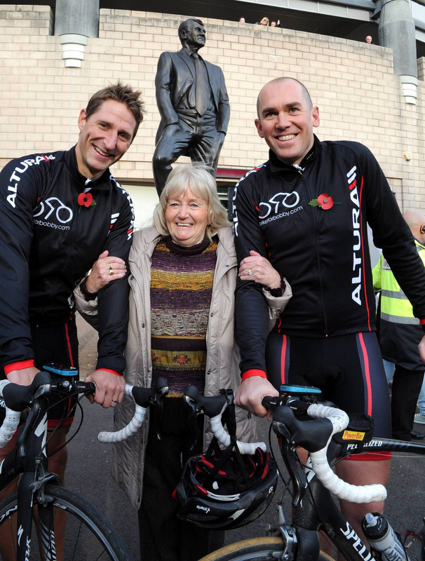 BIKING FOR BOBBY: Robbie Elliott and fellow rider Phil Gray, pictured with Lady Elsie Robson, after the two completed their mammoth charity ride across Europe