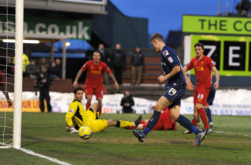BAD JONES: Liverpool's goalkeeper is left to look on after his error led to Matt Smith scoring Oldham's second goal of the afternoon