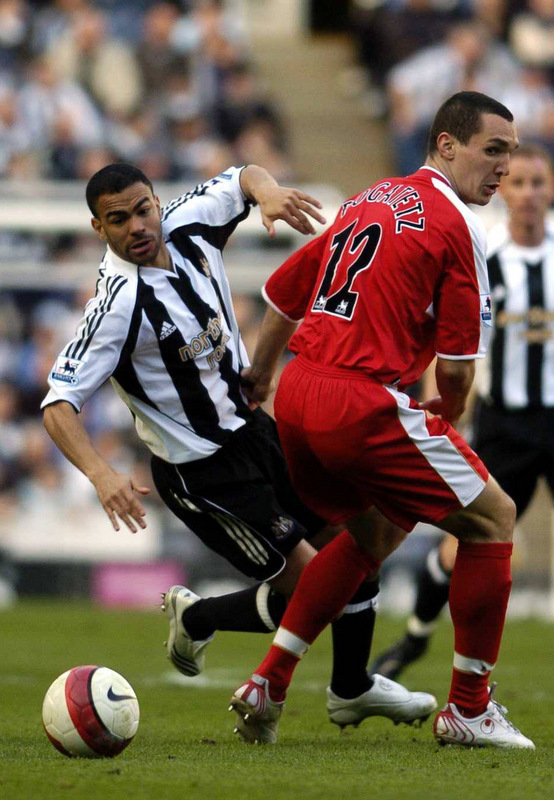 BORO BOUND: Kieron Dyer, pictured playing for Newcastle against Middlesbrough and defender Emanuel Pogatetz in 2007, is to sign a pay-as-you-play deal on Teesside. Pogatetz is poised to sign for West Ham