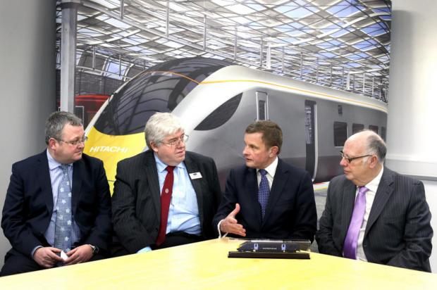 TALKS HELD: David Jones MP, second right, meeting, from left, Hitachi plant manager Darren Cumner, county councillor Neil Foster and Geoff Hunton, of Merchant Place Developments, which owns the Hitachi plant site