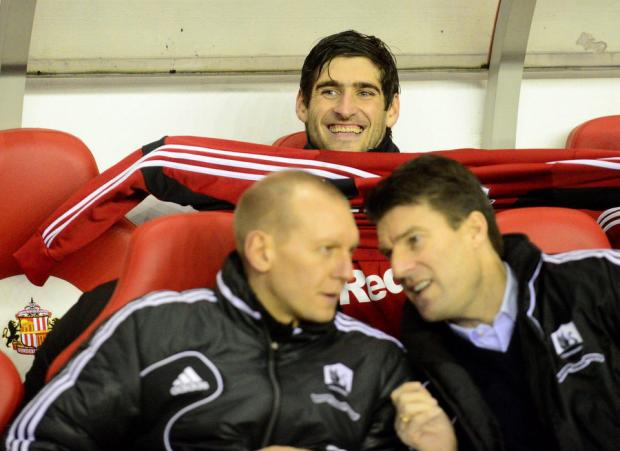 SITTING IN HIS NEW HOME? Swansea striker Danny Graham was in the Swansea City dug-out last night at the Stadium of Light, and a move to Wearside after Sunderland lodged an improved £5.5m bid could happen before tomorrow night's 11pm transfer deadline