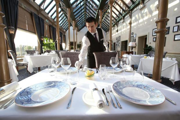 SILVER SERVICE: Waiter Tom Gorz in Rockliffe Hall's refurbished Orangery dining room