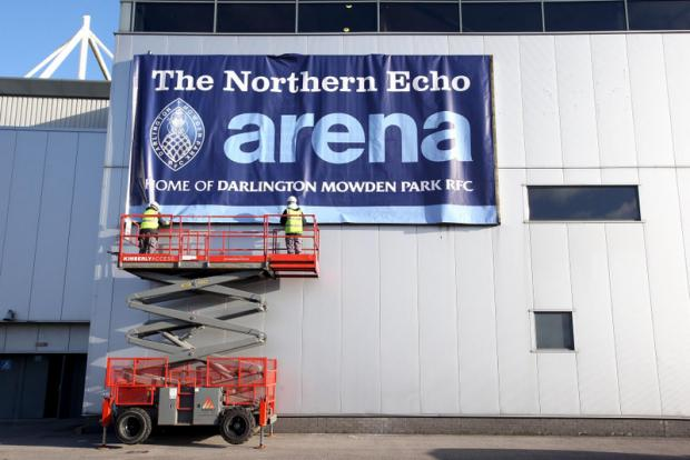 SIGN OF CHANGE: The new sign being put in place prior to Mowden Park's first rugby match at the arena