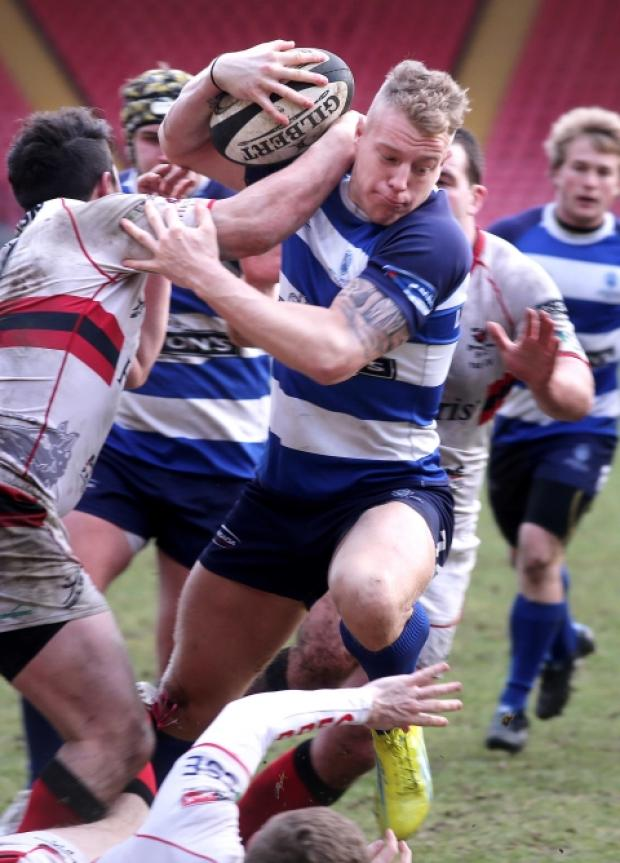 Mowden's Shaun Mcartney fends off the opposition.