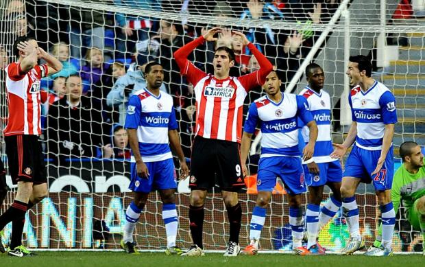 SO CLOSE: Sunderland new boy Danny Graham, centre, rues a missed chance during the premier league match at Reading's Madejski Stadium on Saturday