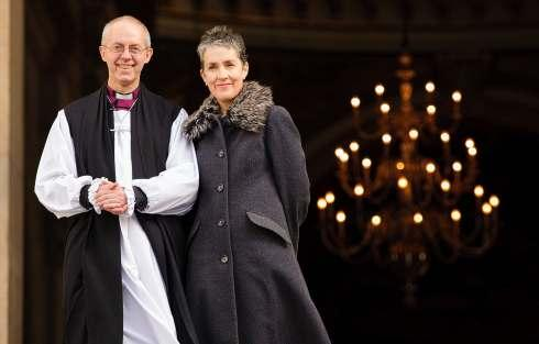 The Most Rev Justin Welby, former Bishop of Durham, stands on the steps of St Paul's Cathedral, London, with his wife Caroline, following a ceremony to formally take office as the new Archbishop of Canterbury.