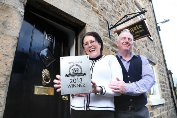 TRAVELLERS' CHOICE: Andrew and Susan Burrell with their award