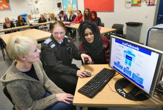 KEY MEASURES: PCSO Jude Hills, gives advice about safety on the internet to Darlington College students Maxine Close, left, and Moriam Basit