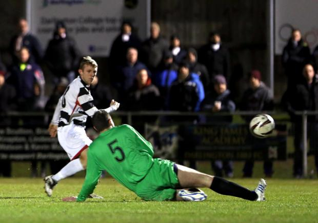 MATCH-WINNER: Darlington striker David Dowson scores the winning goal against Hebburn last night