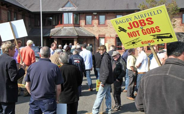 Supporters outside a previous inquiry in Northallerton