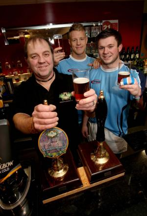 CHEERS TO SUCCESS: Mowden players Shaun McCartney, centre, and Grant Connon join brewer Pete Fenwick to raise a glass of Mowden Mauler