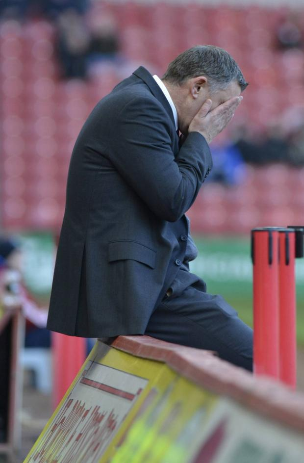 HOMW WOE: Middlesbrough manager Tony Mowbray hides his face as his side looses a 2-1 lead to lose 3-2 at home to relegation-threatened Barnsley