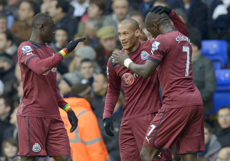 FIRST FOR MAGPIES: Newcastle's Yoan Gouffran, centre, celebrates scoring with team-mates Moussa Sissoko, right, and Papiss Cisse at White Hart Lane on Saturday